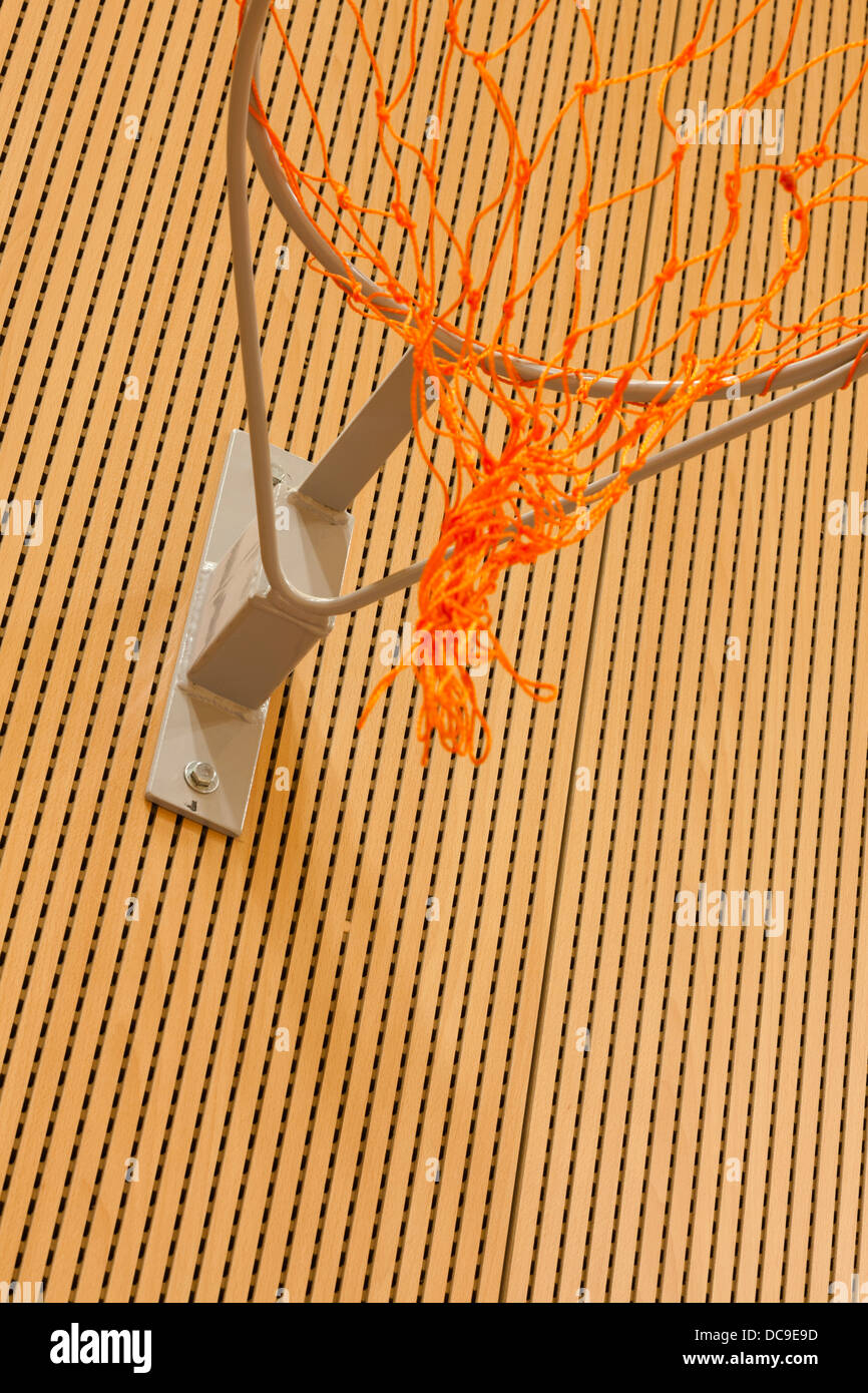 close up of basketball net on sound absorbing wall - Stock Image
