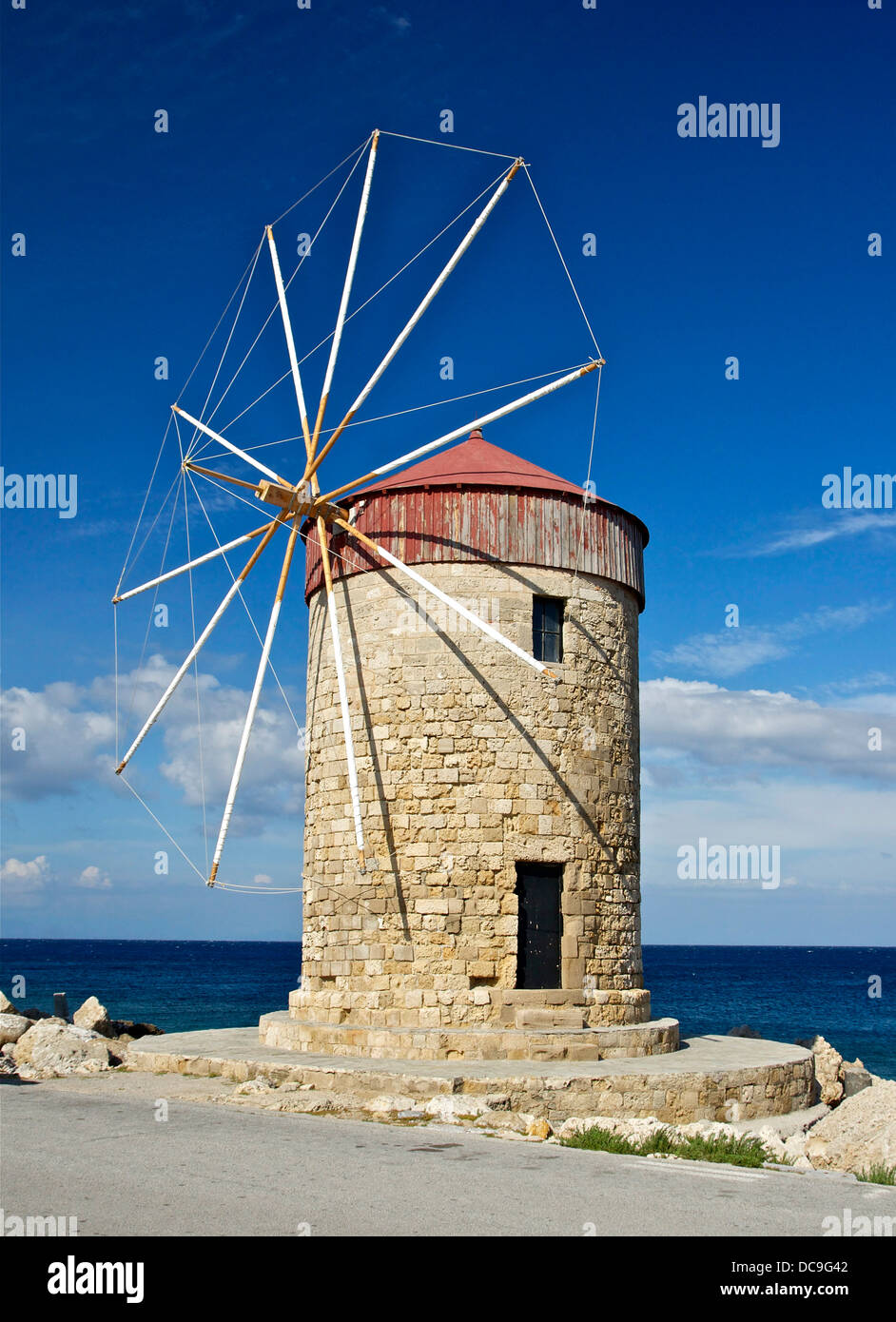 Windmill (14th century, restored) on the harbour of Rhodes, Greece. - Stock Image