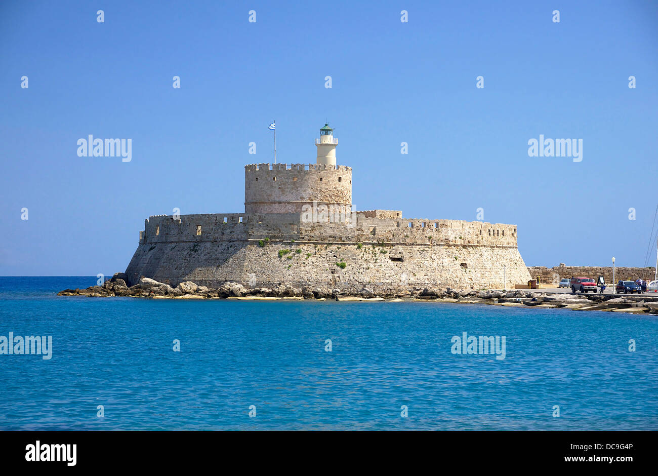 fort Saint Nicolas (and lighthouse), 14th century, entrance of the old harbour of Rhodes, Greece. - Stock Image