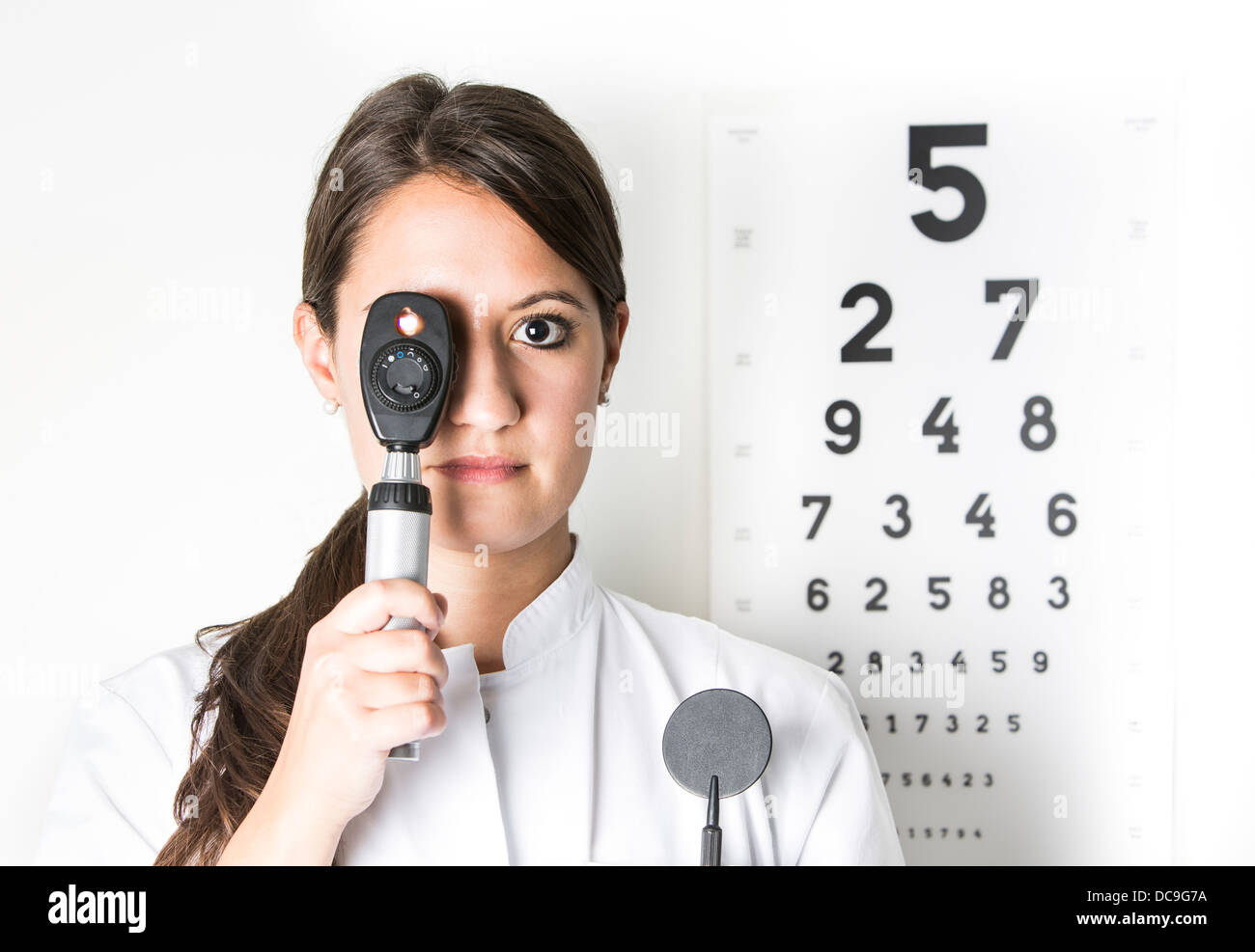 Young eye doctor W25 with ophthalmoscope - Stock Image