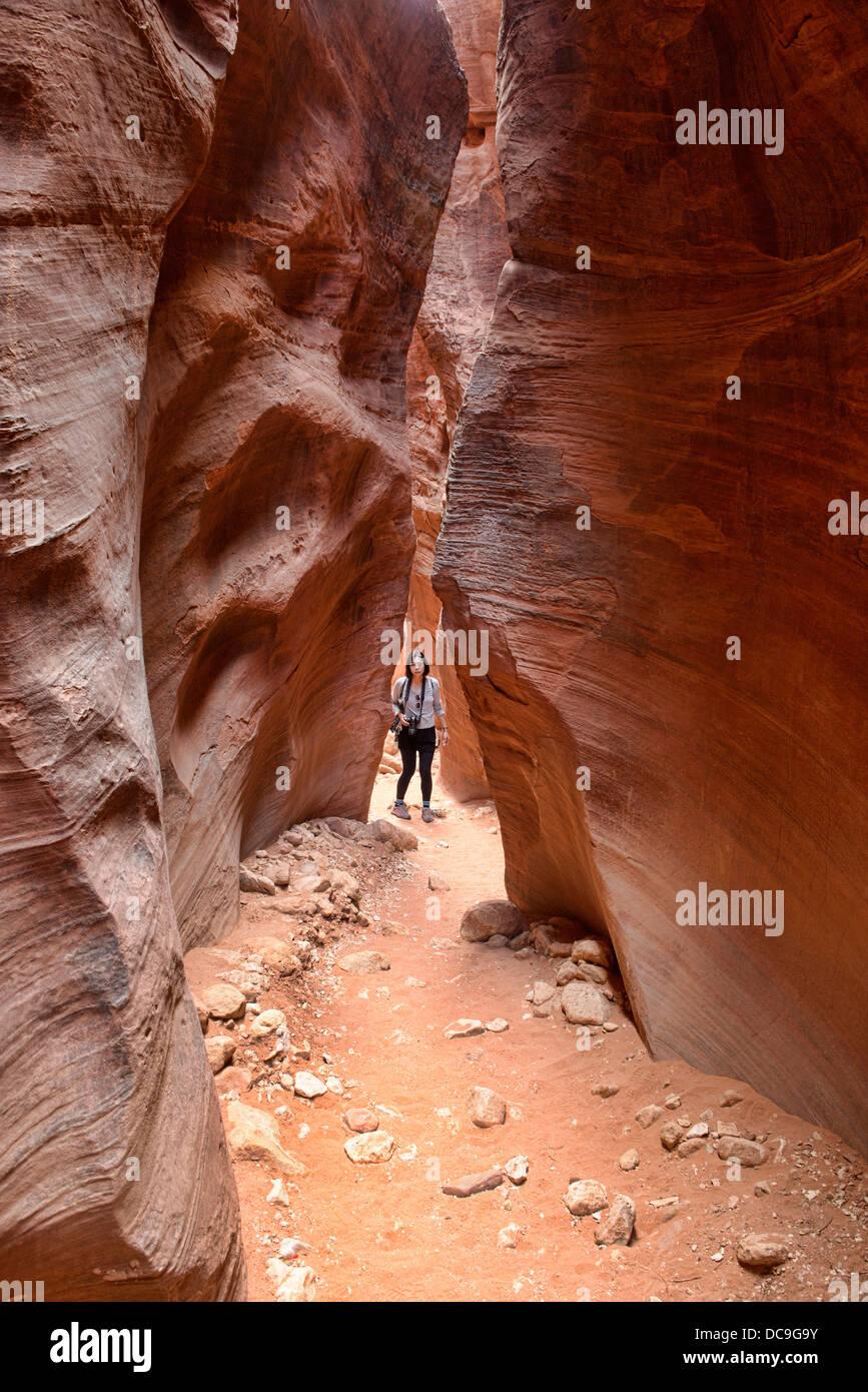 Hiker in the Buckskin Gulch slot canyon, Kanab, Utah Stock Photo
