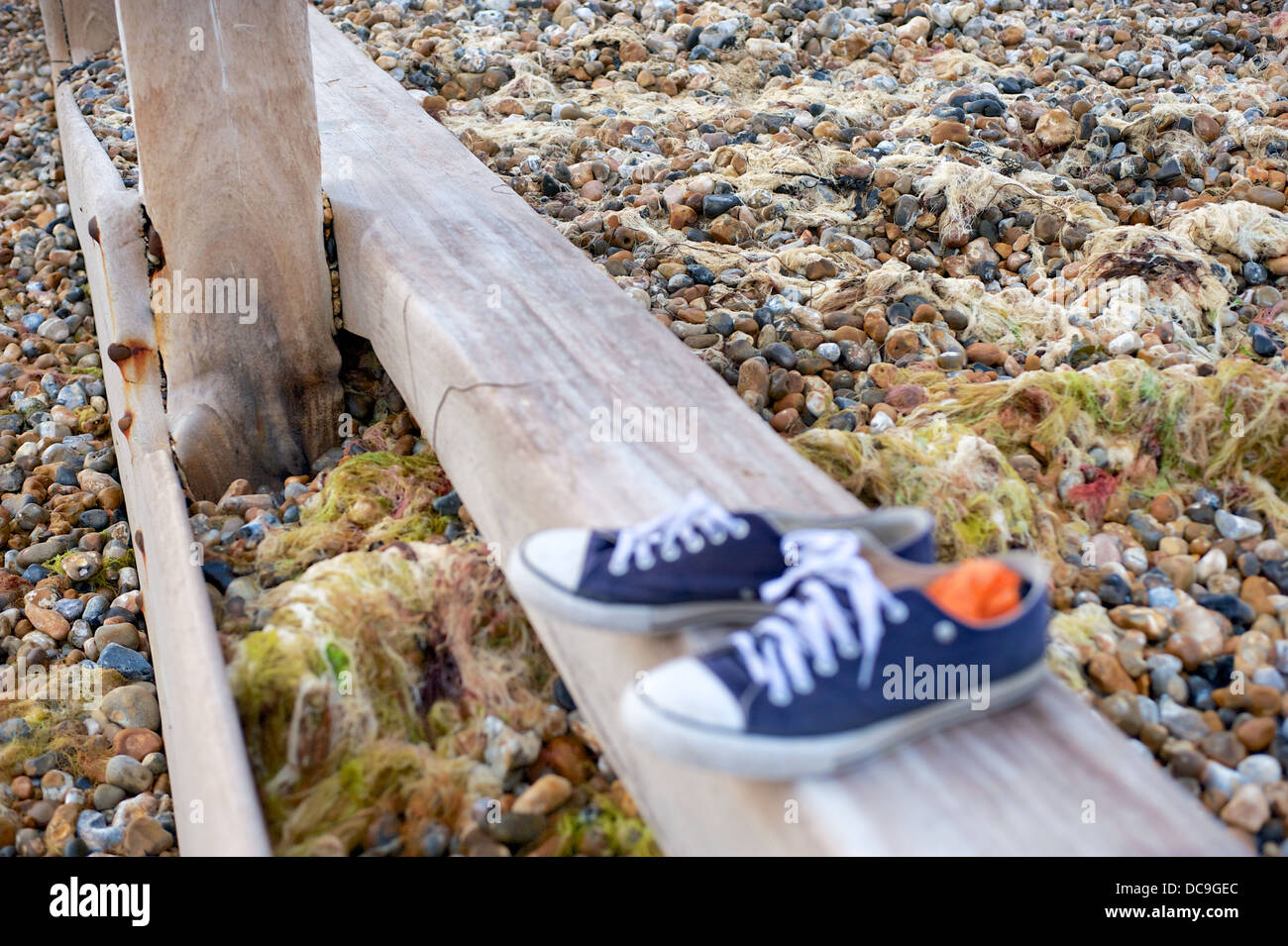 take your shoes off on the beach - Stock Image