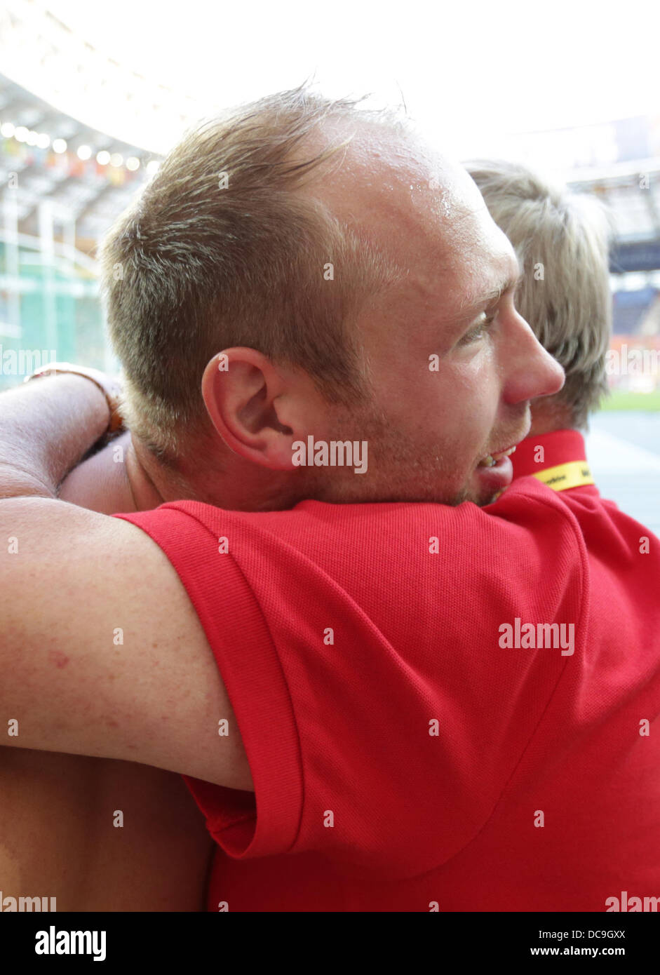 Moscow, Russia. 13th Aug, 2013. Germany's Robert Harting (L) celebrates with coach Robert Goldmann after winning - Stock Image
