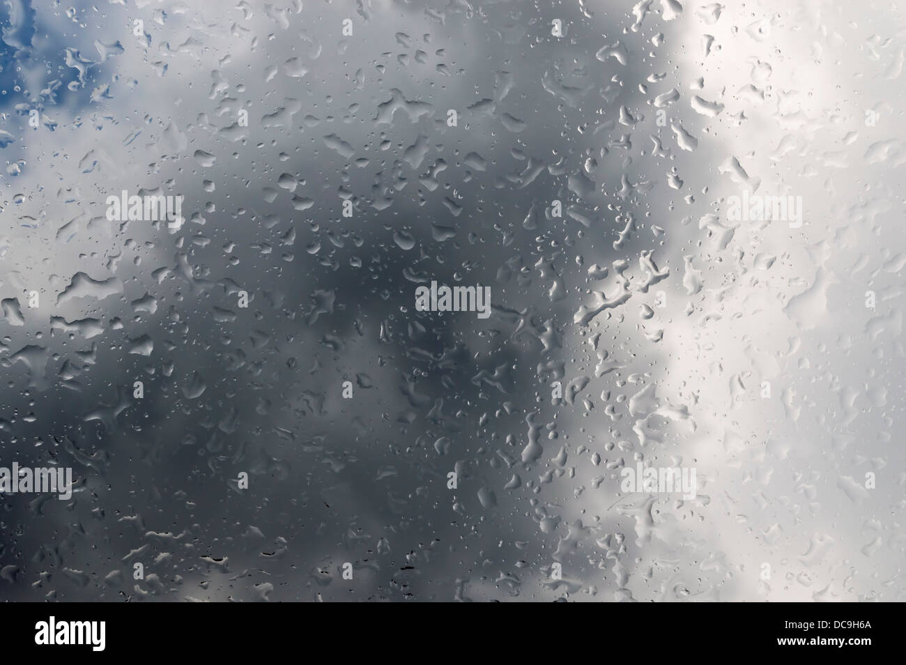 Droplets of water on window - Stock Image