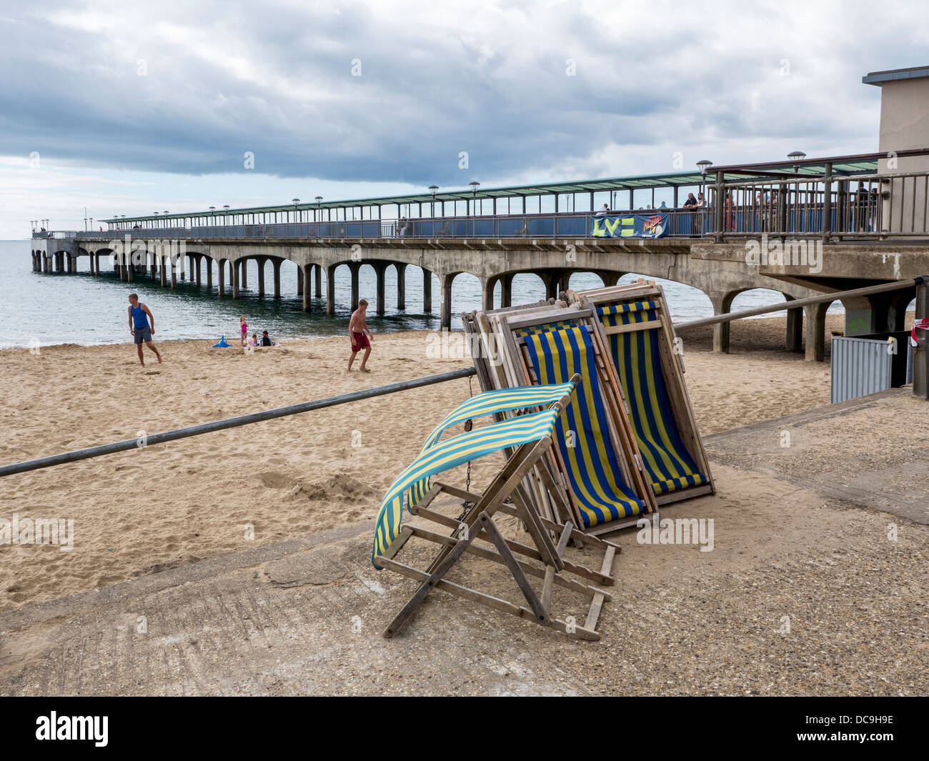 Deck chairs on bournemouth beach stock photos deck chairs on deck chairs beach and pier on a windy summer day boscombe bournemouth negle Image collections