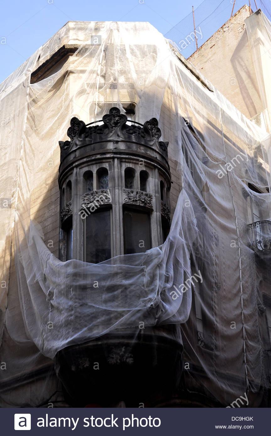 Ancient modernist style building in restoration, Sant Pere Més Alt street, Ciutat Vella, Barcelona, Spain - Stock Image