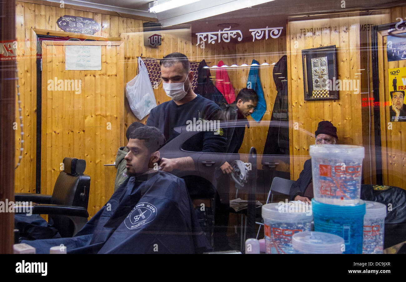 Window of a barber shop in Brick Lane, London Stock Photo