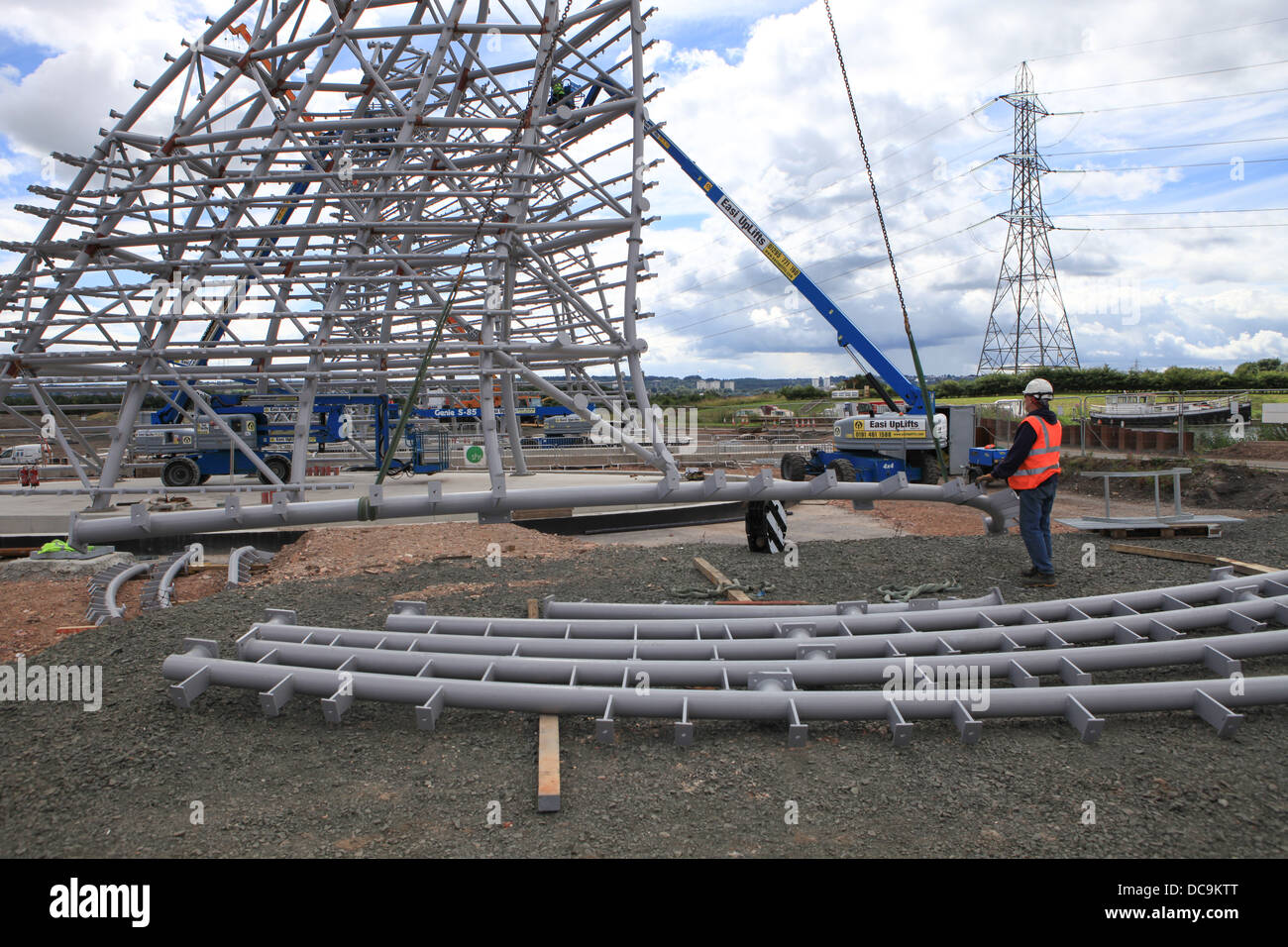 A site engineer is slinging a piece of steelwork to be lifted by a crane - Stock Image