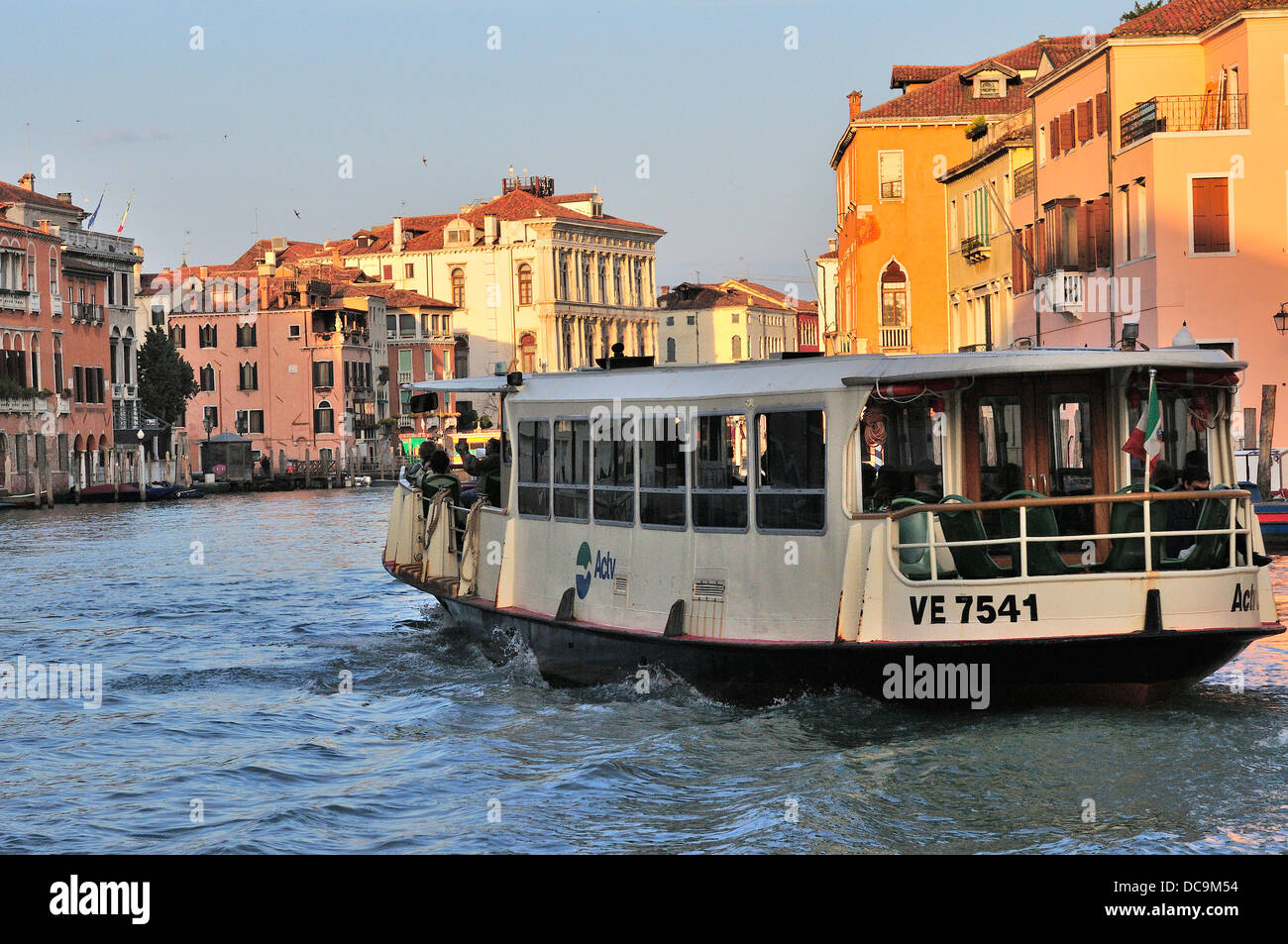 Vaporetto water bus on the Grand Canal  taken people towards the rail bus terminals at  the end of island of  Venice - Stock Image