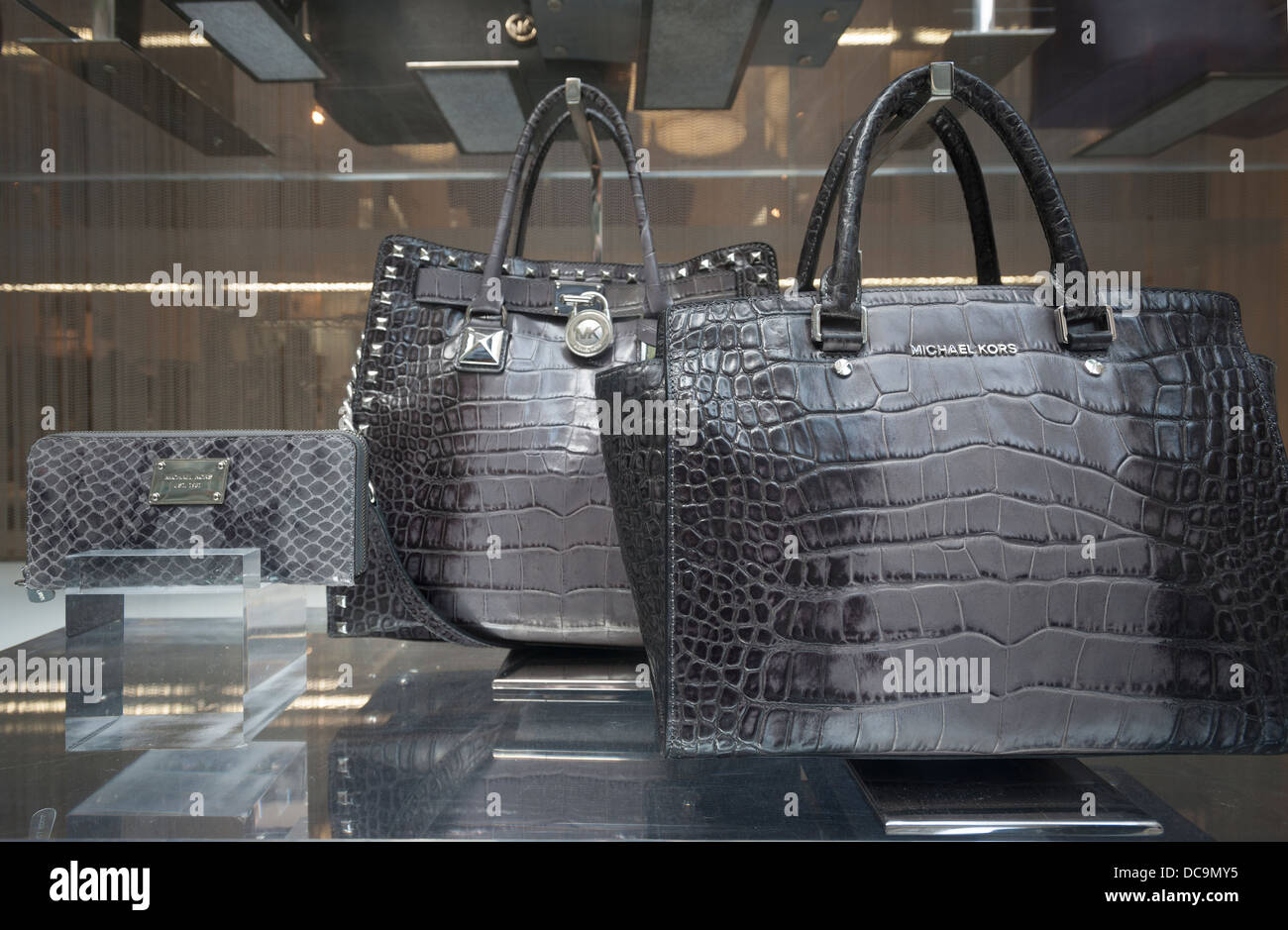 5a3c86f91b31 Handbags are featured in the window of the Michael Kors store on Fifth  Avenue in New