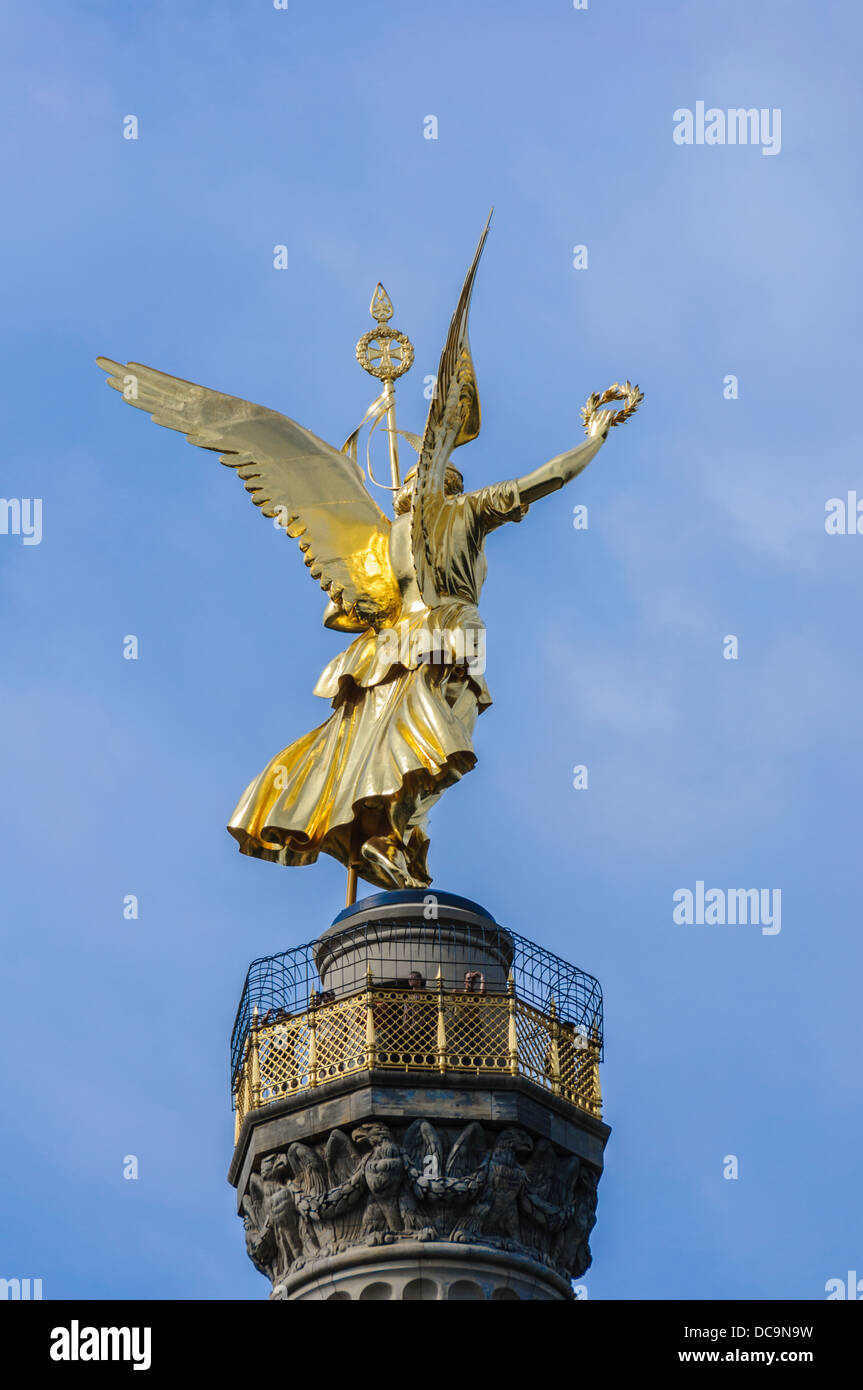 Backside of the golden Statue of Victoria on top of the Victory Column holding a spear and laurel wreath – Berlin Stock Photo