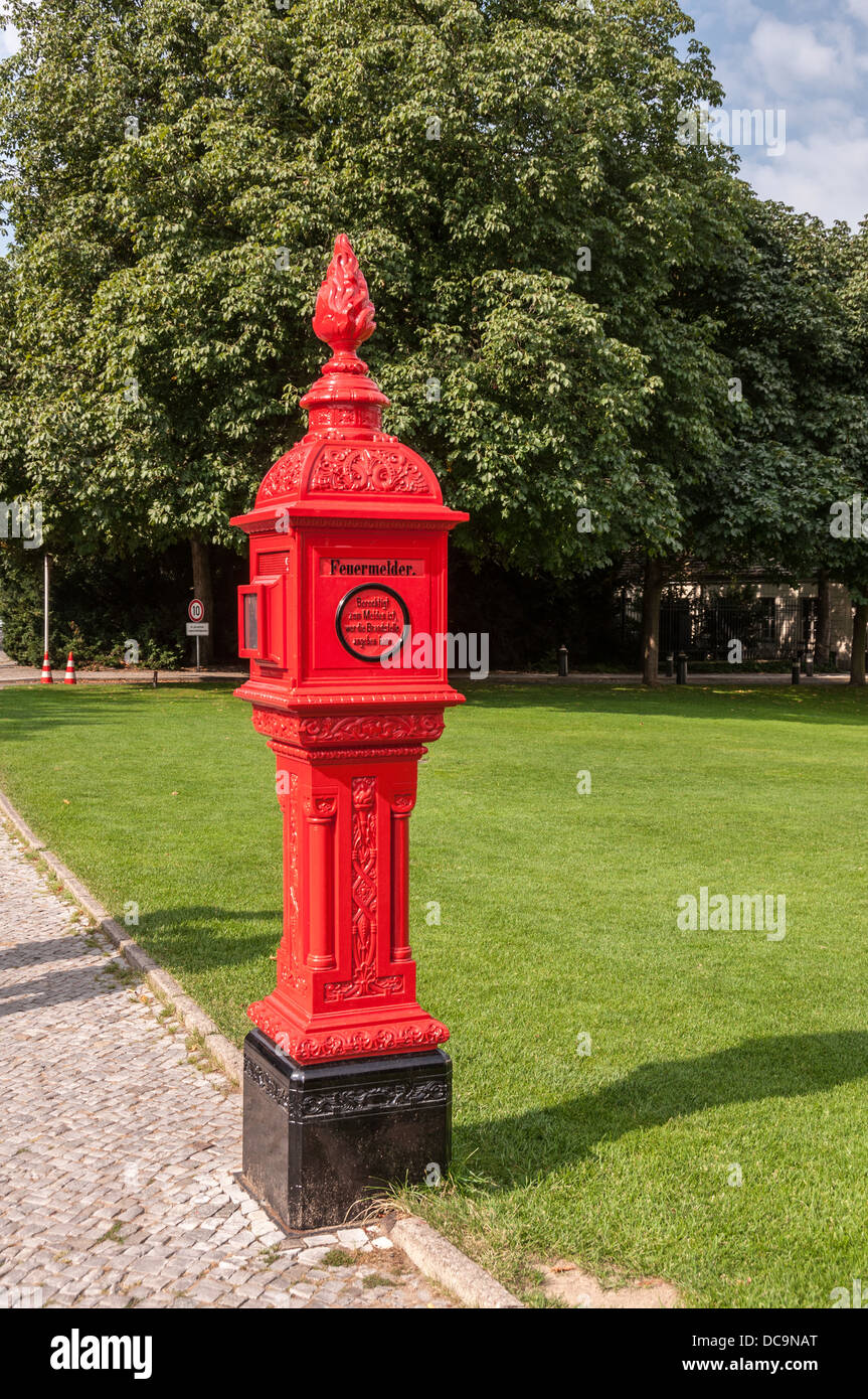 Historic red firebox in front of the Bellevue Palace, Schloss Bellevue, residence of the President of Germany, Berlin Stock Photo