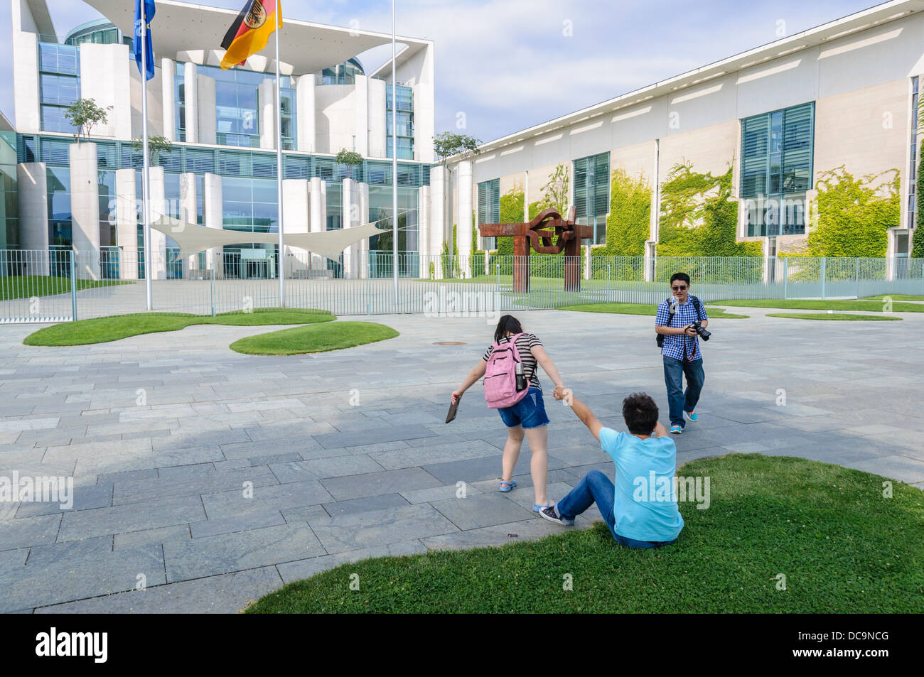 Asian tourists in front of the German Chancellery building - Berlin Germany Stock Photo