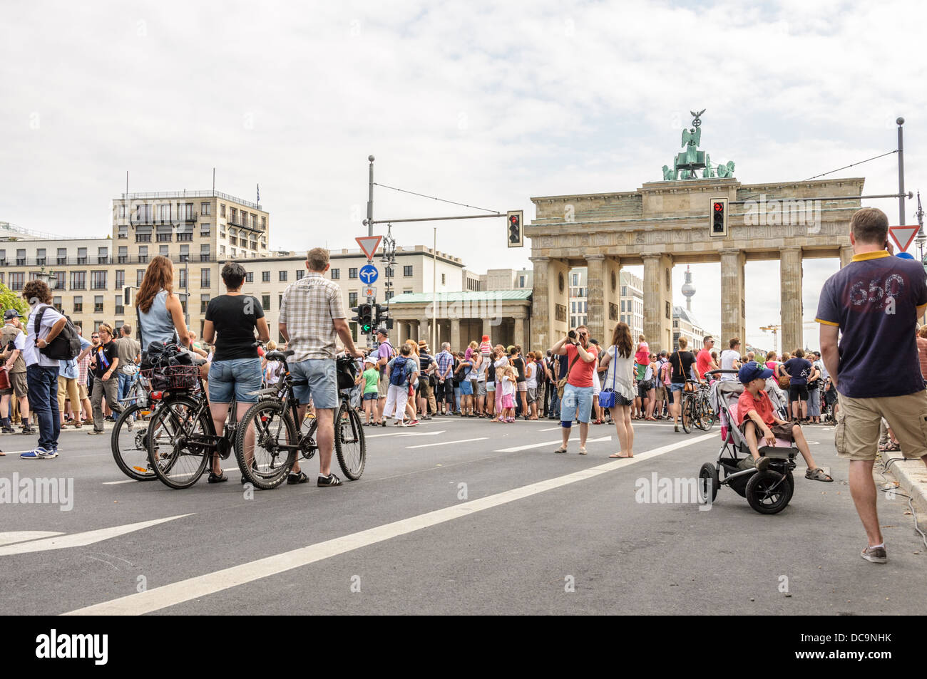 Many people on the 17th of June Street and Square and Brandenburg Gate, participating in a public event – Berlin Stock Photo