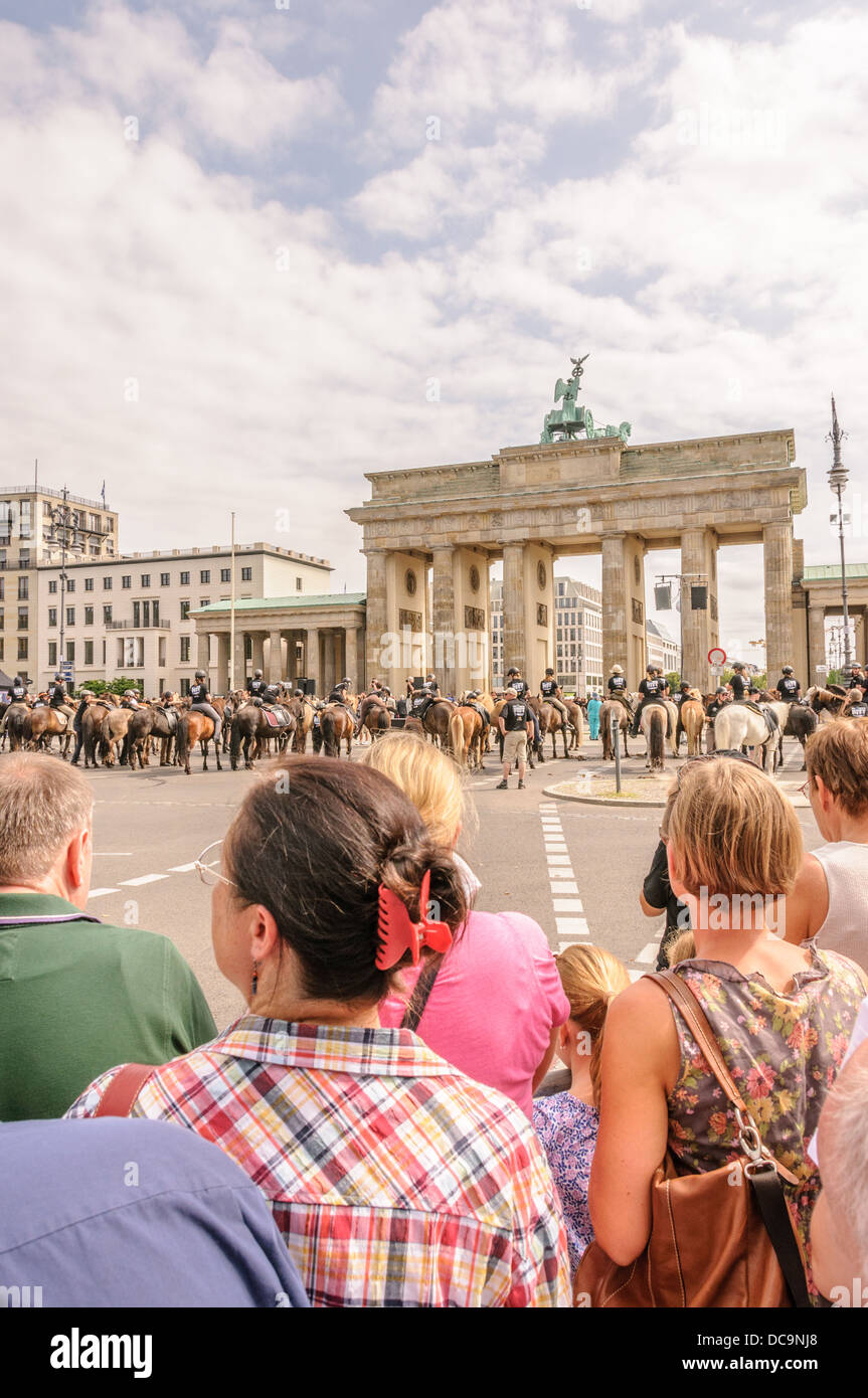 Many people on the 17th of June Street and Square and Brandenburg Gate during IPZV Icelandic horses world championship, Stock Photo