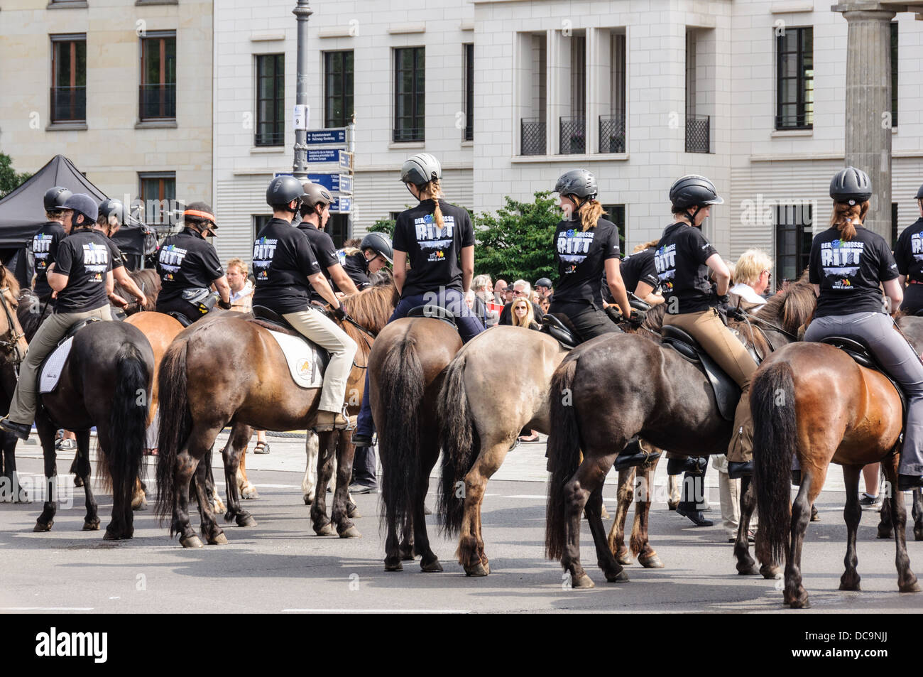 Riders wearing safety helmets, riding Icelandic horses - 17th of June Street Square Berlin Germany Stock Photo