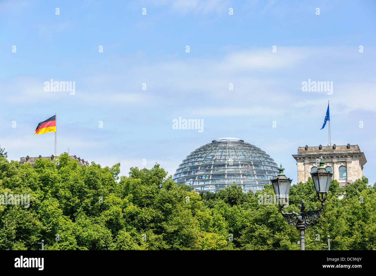 The Reichstag building with the glass dome and the German and European flag seen from the south - Berlin Germany Stock Photo