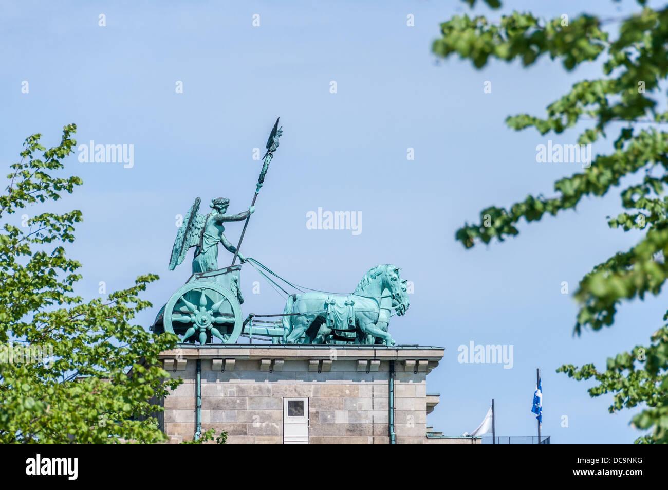 The Berlin Quadriga statue on top of of the Brandenburg Gate - Berlin Germany Stock Photo