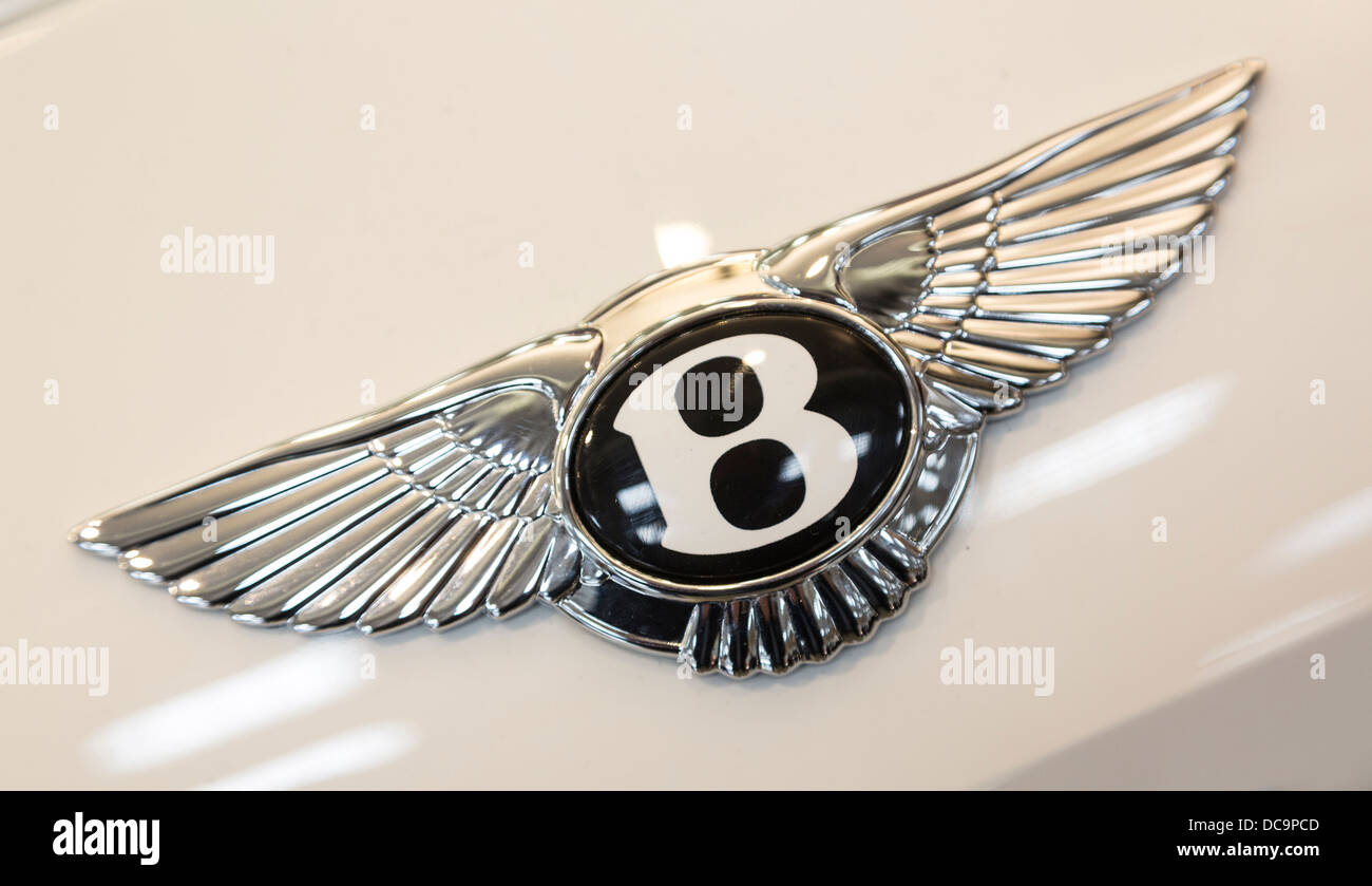 detail of badge of Bentley Flying Spur car, Duty Free area, Doha, Qatar - Stock Image