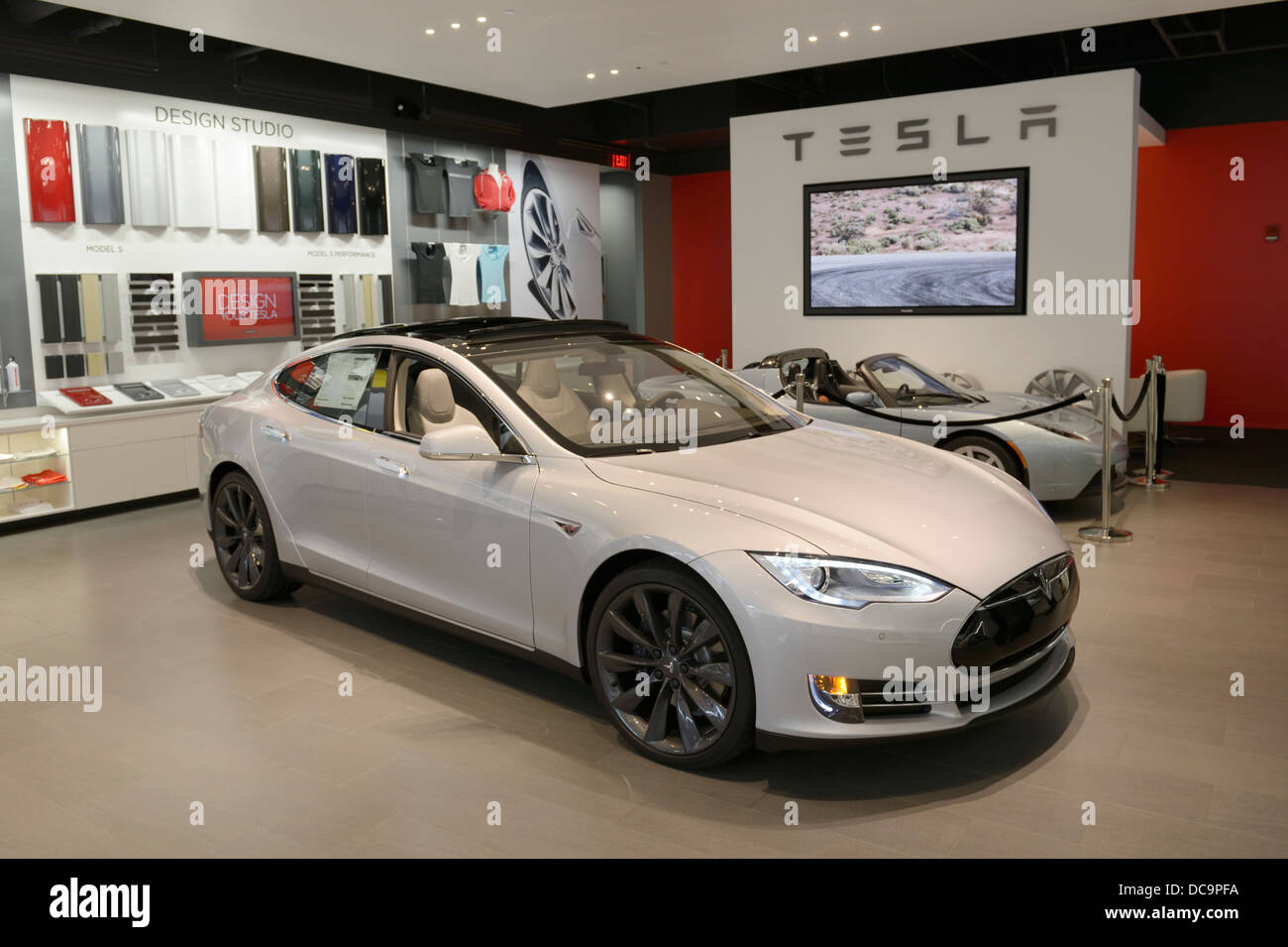 Tesla electric car dealer (retail store) in a shopping mall, NJ, USA with Model S sedan - Stock Image