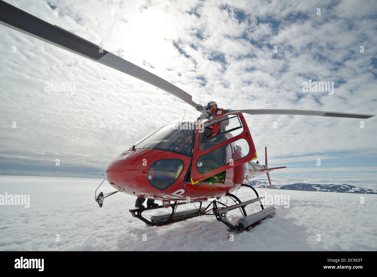 North South Polar's safety team leader, John Bradley, boards an Air Greenland A-Star helicopter heading to a - Stock Image