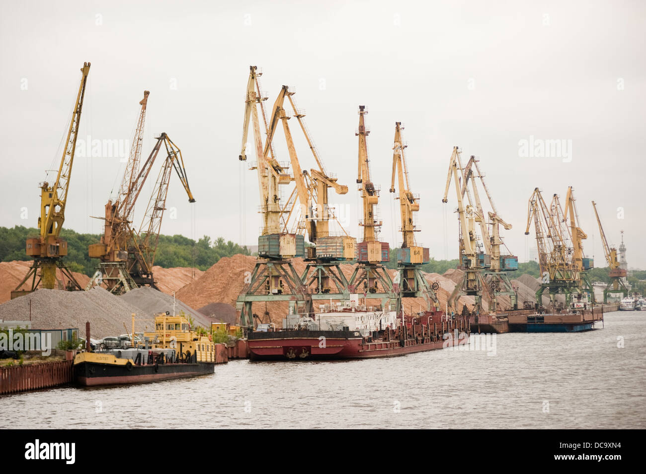 Sand and gravel cargo port along Moscow Canal and ships loaded Russia - Stock Image