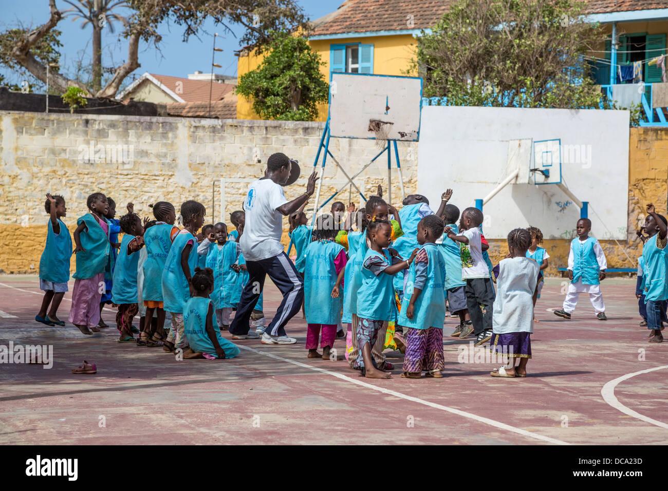 Elementary School Children Exercising in Playground, Goree Island, Senegal. - Stock Image