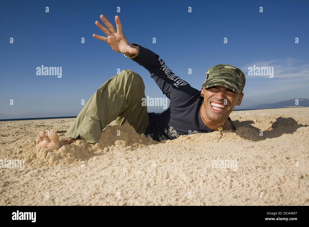 Man Coming Out of a Ditch Stock Photo