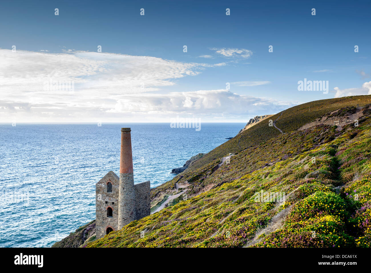 The coast at St Agnes in Cornwall with the Wheal Coates tin mine perched on the edge of the cliffs. - Stock Image