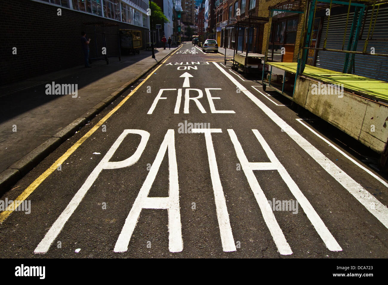 Fire path no entry road markings on Leather lane in London - Stock Image