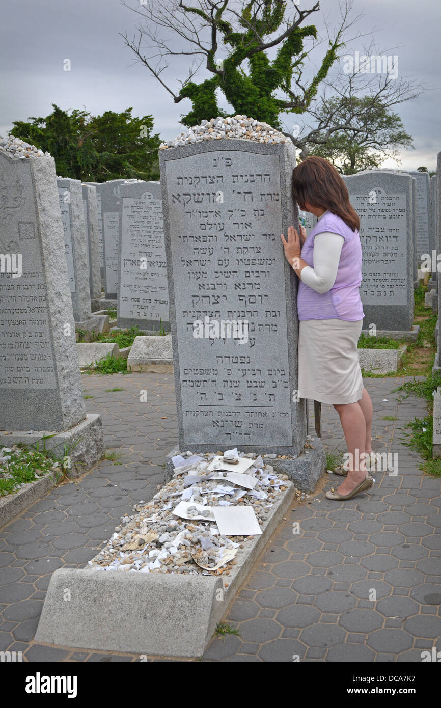 Young religious Jewish woman praying at The Ohel at the burial place of the Lubavitcher Rebbe's wife. In Queens, - Stock Image