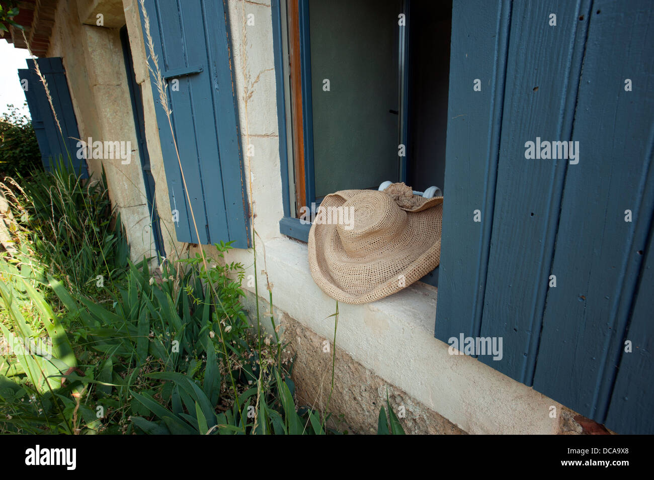 Hat in window at Fajac-La-Selve at Pech-Luna in Languedoc-Roussillon, Southwest France. July 2013 - Stock Image