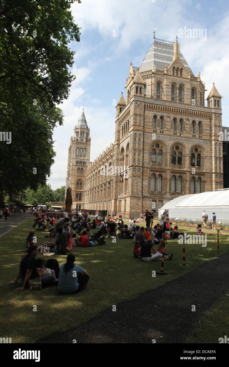 People having picnics with Sensational Butterflies exhibit Natural History Museum London UK July 2013 - Stock Image