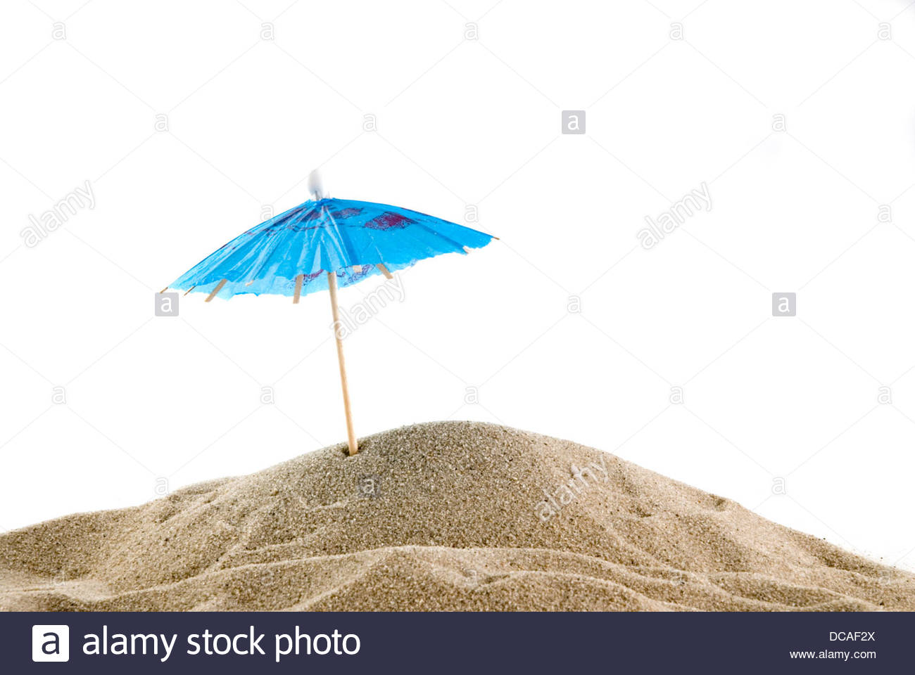 One blue parasol on the beach - Stock Image