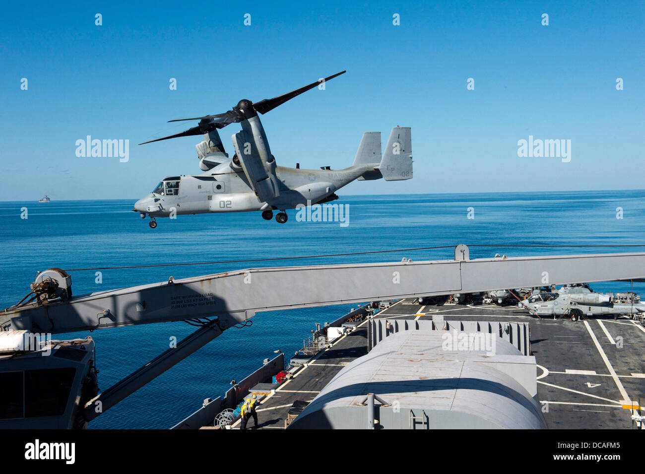 An MV-22 Osprey launches from the flight deck of amphibious transport dock ship USS Denver (LPD 9). Denver is on - Stock Image