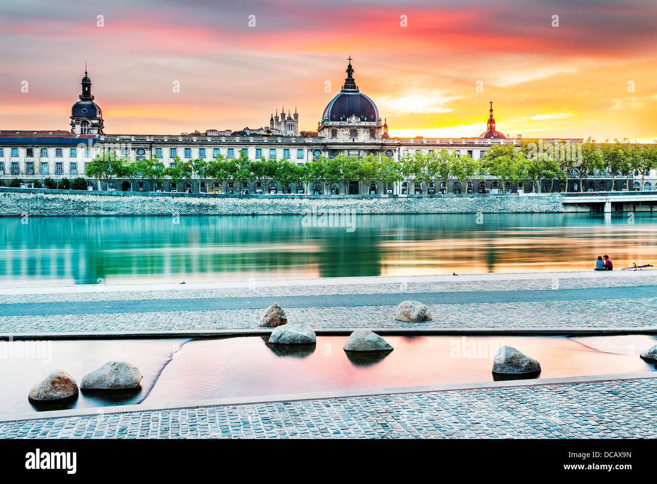 night view from Rhone river in Lyon city with Hotel Dieu and Fourviere cathedral, France - Stock Image