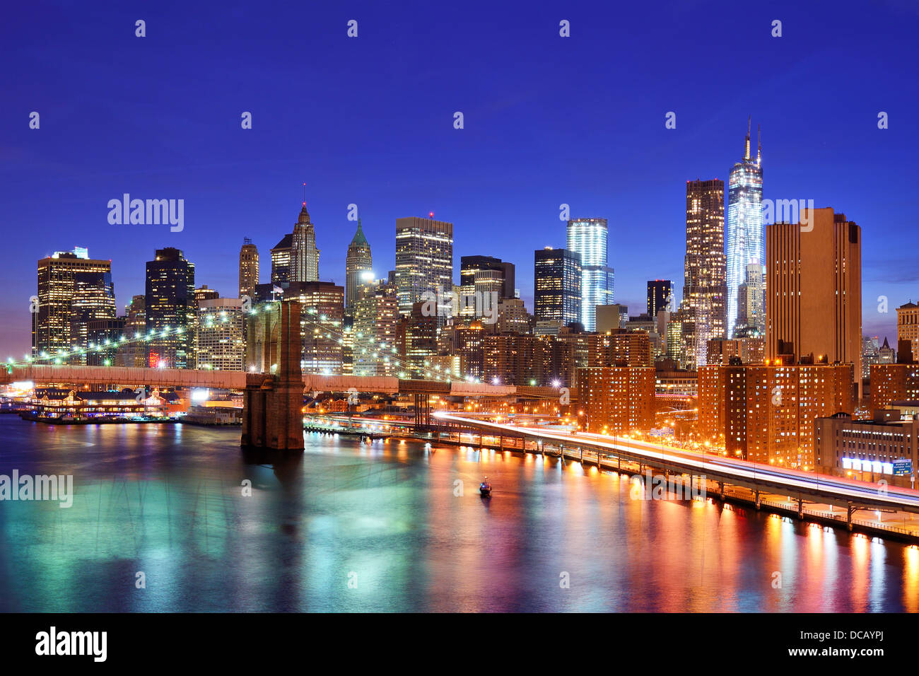 Lower Manhattan from above the East River in New York City. - Stock Image