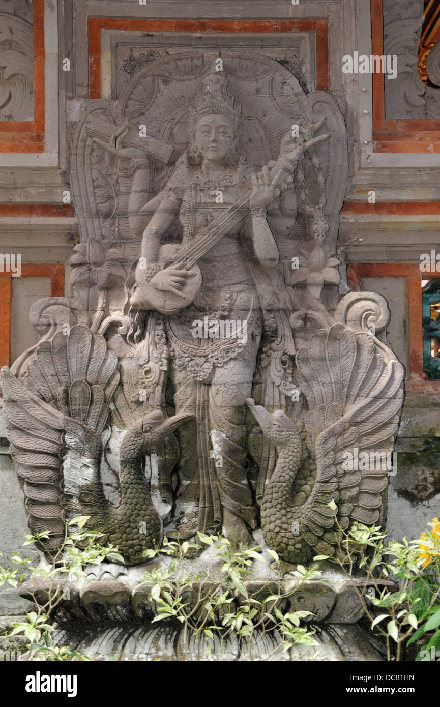 Sculpture at the temple of Dalem at Ubud on the island of Bali, Indonesia - Stock Image