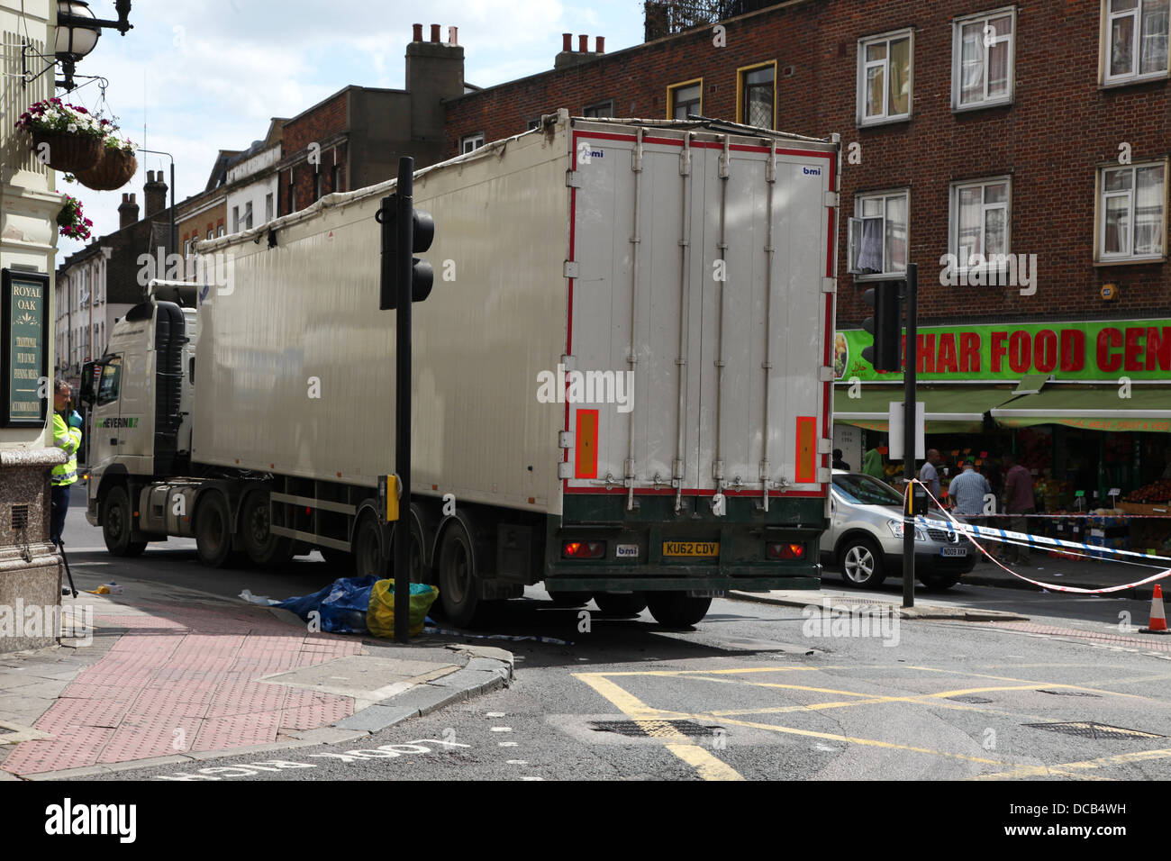 Police and contractors attend to a lorry following a road accident - Stock Image