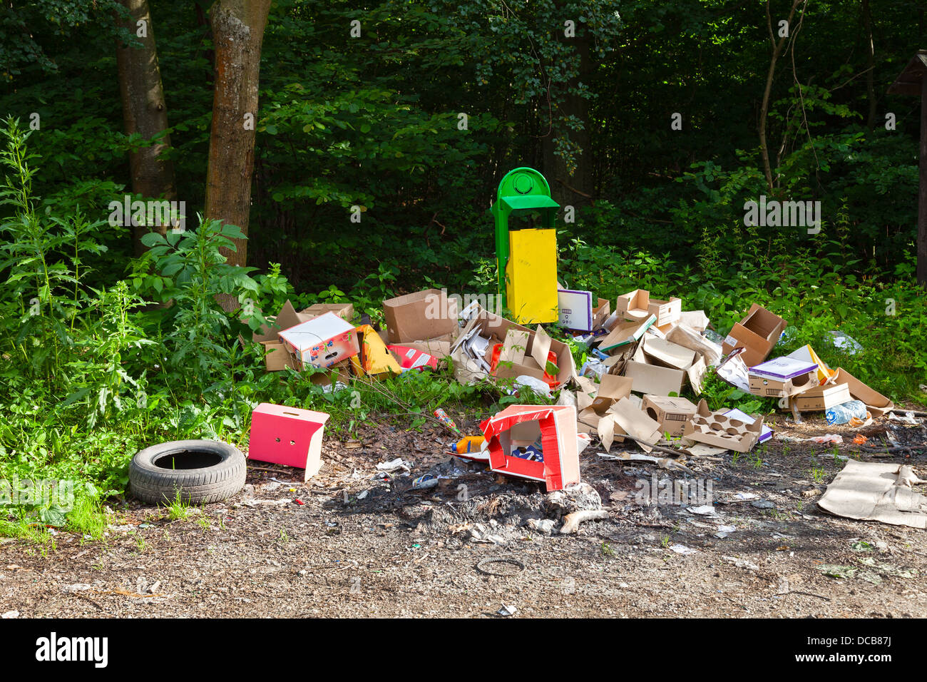 Garbage in landfill near forest - environment pollution. - Stock Image