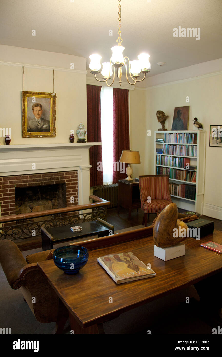 The Library at Rowan Oak the home of William Faulkner in Oxford Mississippi USA. Portrait of Faulkner over the fireplace & The Library at Rowan Oak the home of William Faulkner in Oxford ...
