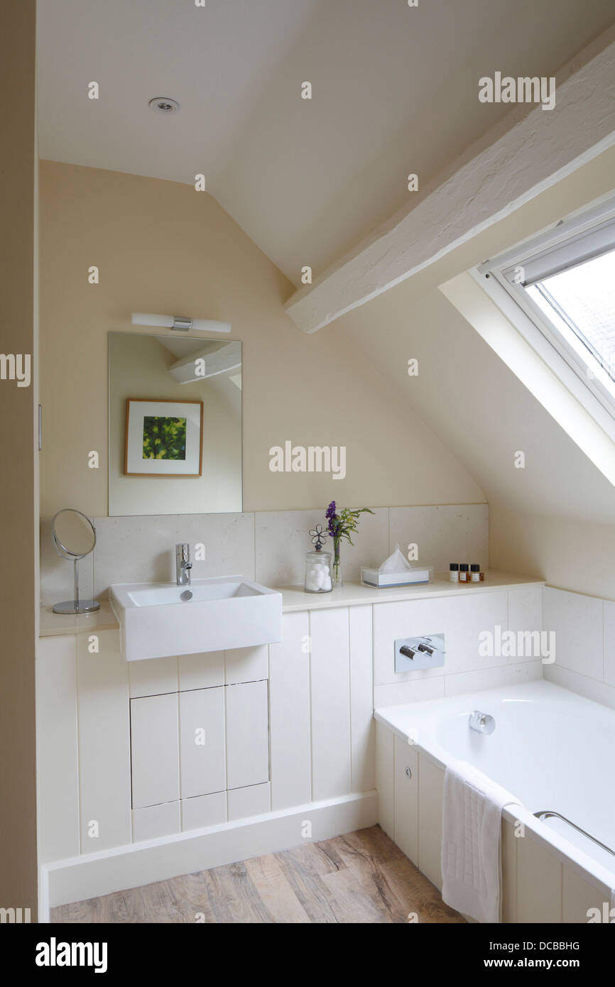 Pale Bathroom With Sloping Ceiling And Skylight Barnsley