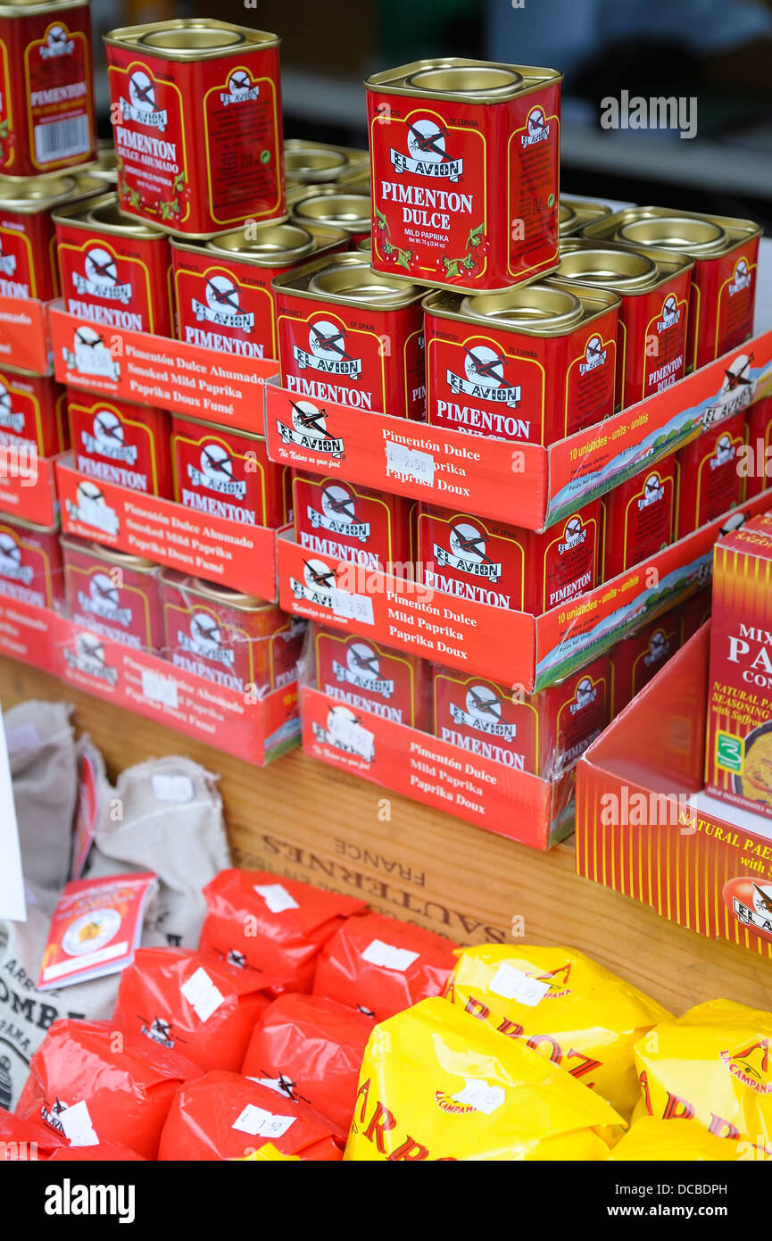Tins of Pimento dulce paprika powder used for seasoning whilst cooking in the kitchen - Stock Image