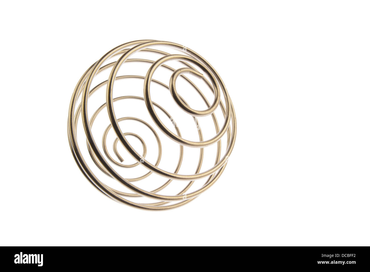 Iron wire tangled up into a spiral ball resulting in a shiny chrome sphere, right tilted and isolated in white background Stock Photo