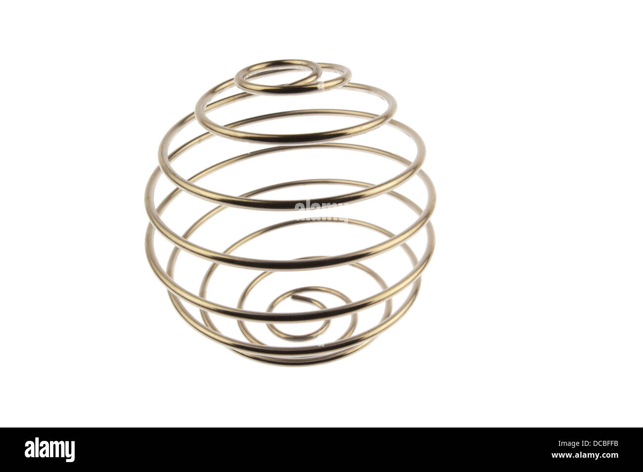 Iron wire tangled up into a spiral ball resulting in a shiny chrome sphere and standing straight up and isolated Stock Photo