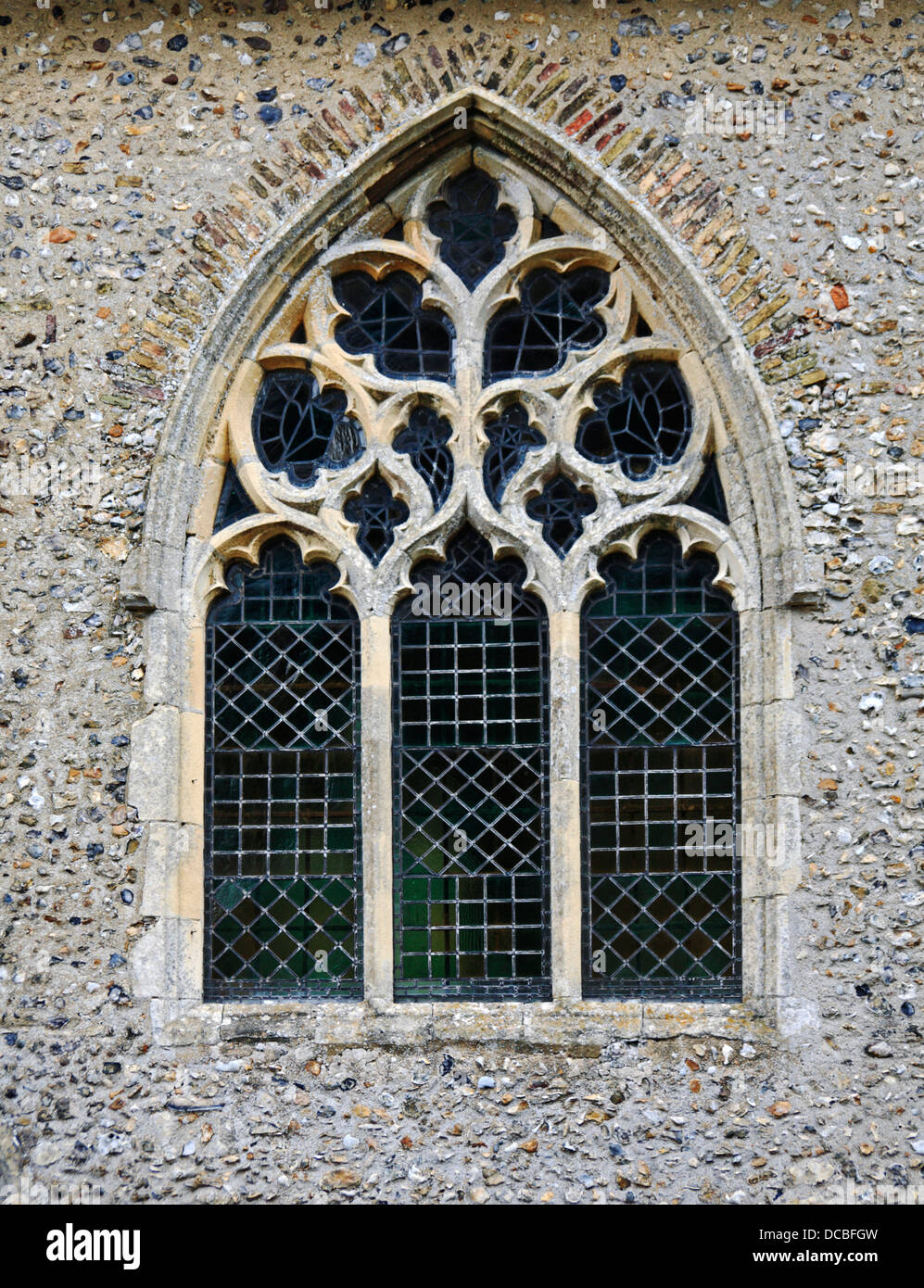 An example of Perpendicular tracery in a window at the church of All Saints at Weston Longville, Norfolk, England, - Stock Image