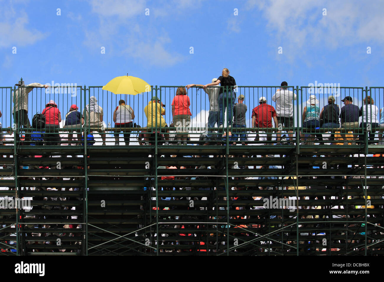 People watching an event on bleachers - Stock Image