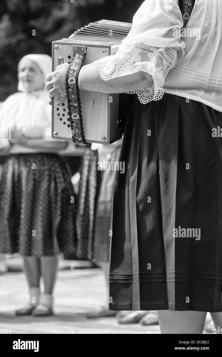 Woman with button key accordion on folk show Stock Photo