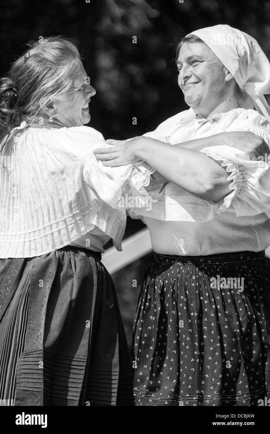 Folk dancing women - Stock Image