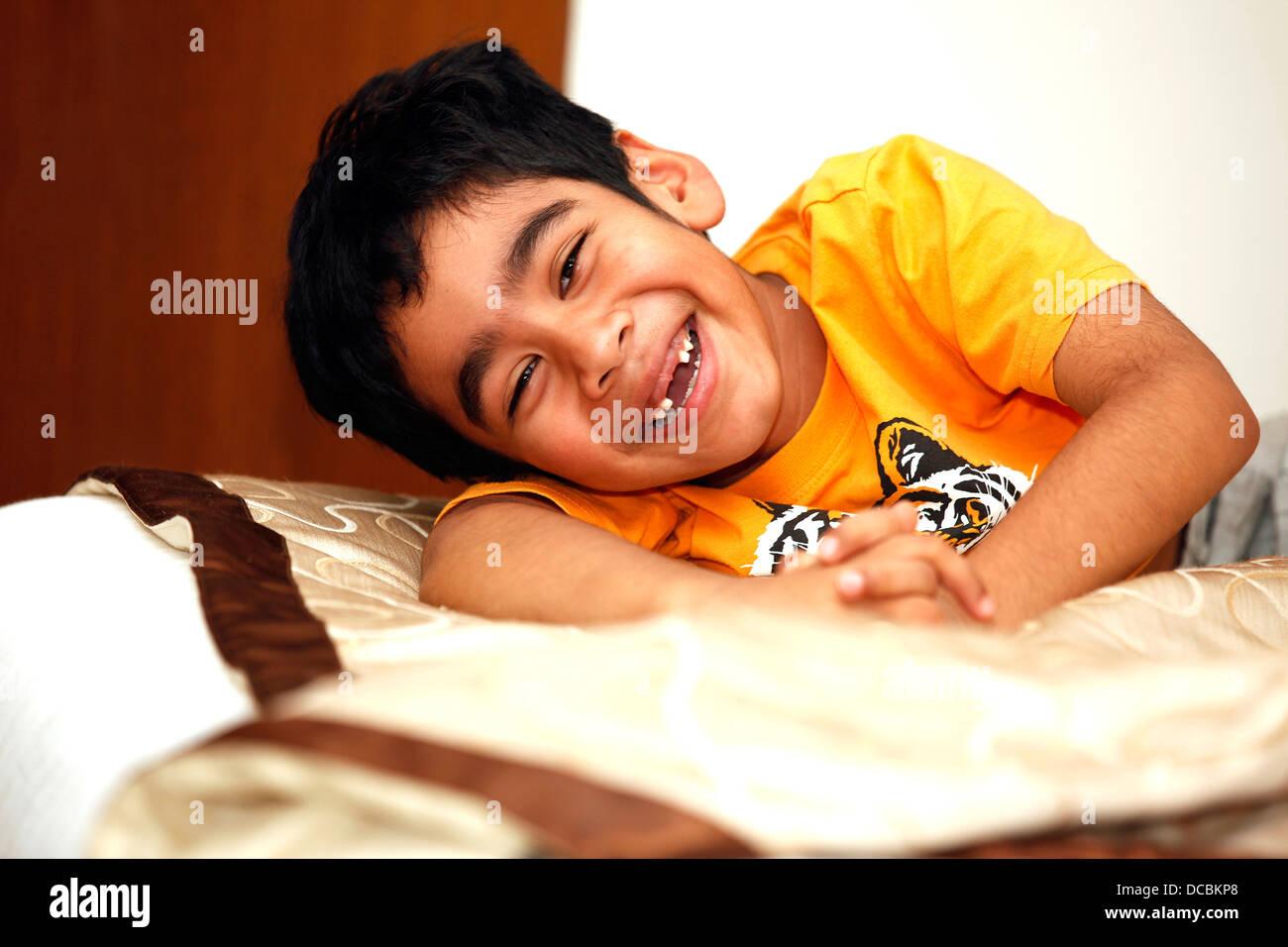 youth,kid,young,child,happy,joyous,Indian,missing teeth,broken teeth,cheerful - Stock Image